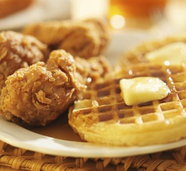 Belgian waffles and herby fried chicken with chipotle maple syrup